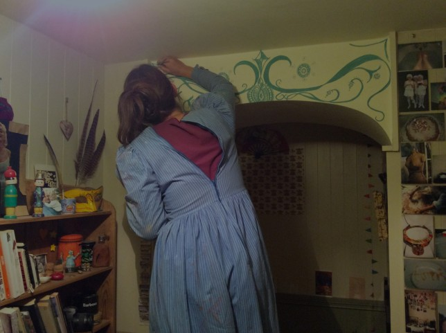 Painting the archway in my painting frock