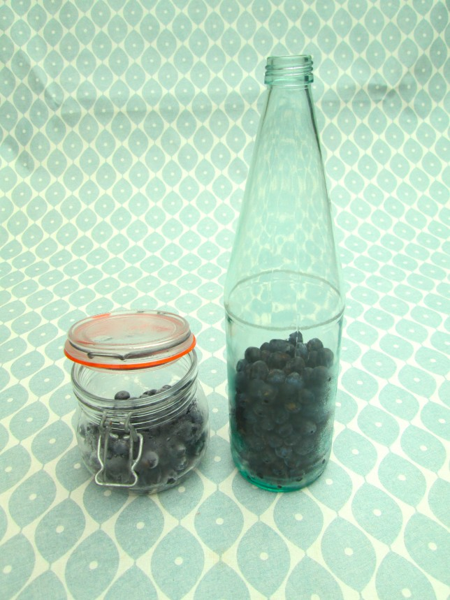 Use a large glass bottle and put in the oven on a low heat for about 20-30mins. This sterilises the bottle for you. Once you have done that, fill half the bottle with the sloes.